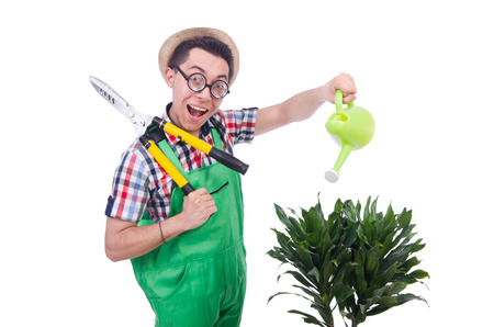 Funny man trimming plans in his garden photo
