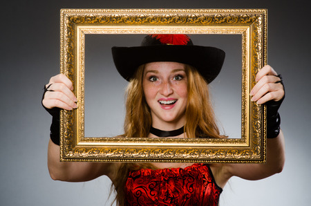Woman pirate with picture frame photo