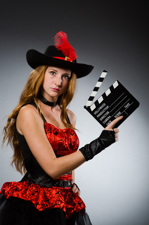 Woman in pirate costume with movie board photo