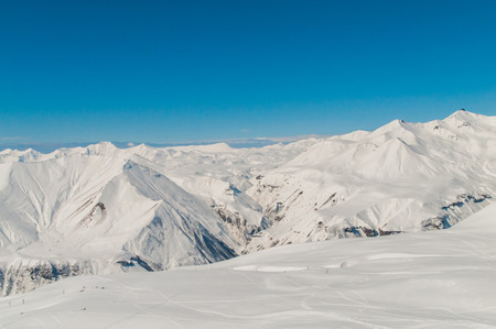Snow mountains on bright winter day Stock Photo