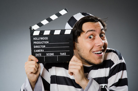 an inmate: Inmate with movie clapper board