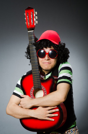 man with funny haircut and guitar photo