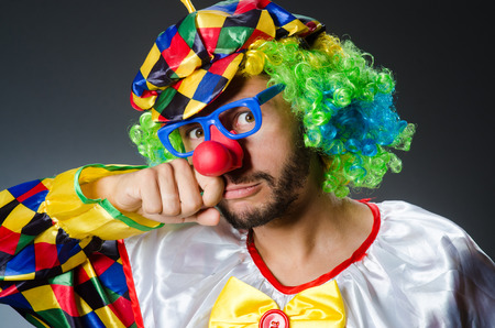 Funny clown in colourful costume photo