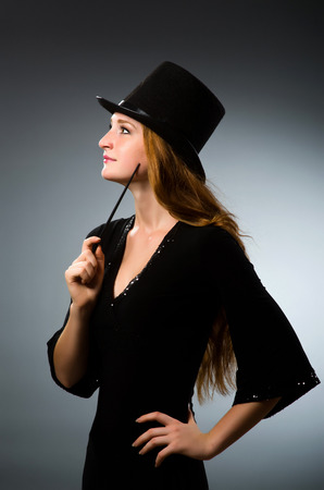 conjuror: Woman magician doing her tricks with wand