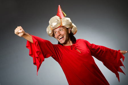 Funny wizard wearing red dress photo