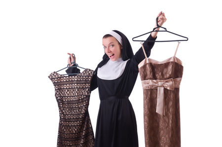 Nun choosing clothing on the hanger isolated on white photo