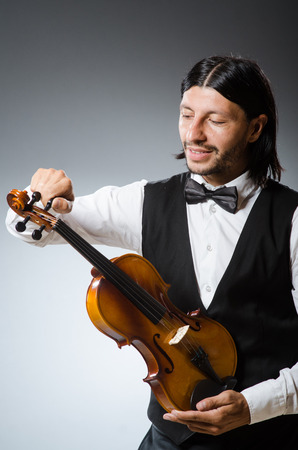 fiddle: Funny fiddle violin player in musical concept