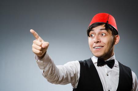 Man wearing traditional turkish hat fez photo