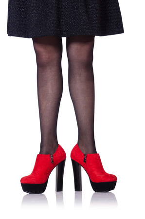 Woman legs with red shoes isolated on the white