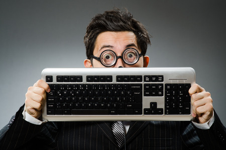 Comouter geek with computer keyboard photo