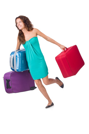 Woman traveller with suitcase isolated on white photo