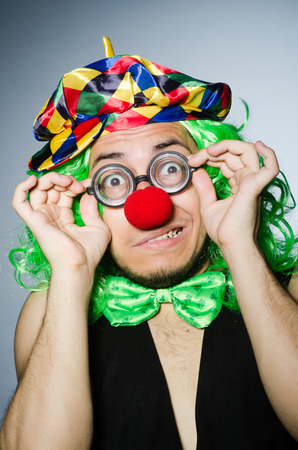 Funny clown against the dark background photo