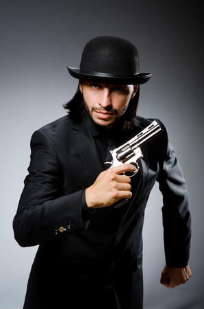 Man with gun and vintage hat photo