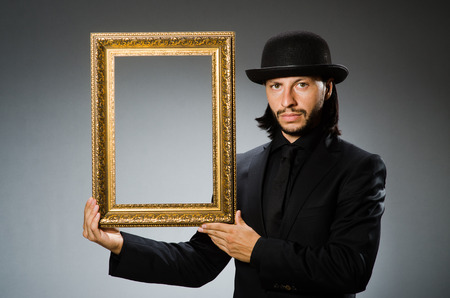 topper: Man in topper hat and picture frame