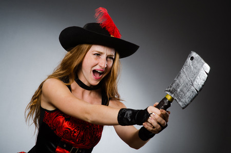 Woman pirate with sharp weapon photo