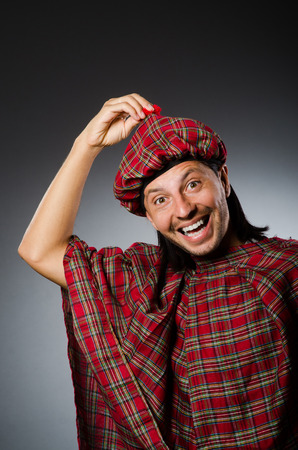 Funny scotsman in traditional clothing photo