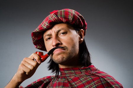 Funny scotsman with smoking pipe photo