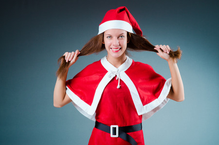 Snow santa girl in red costume photo