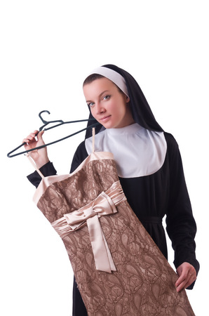 pious: Nun choosing clothing on the hanger isolated on white