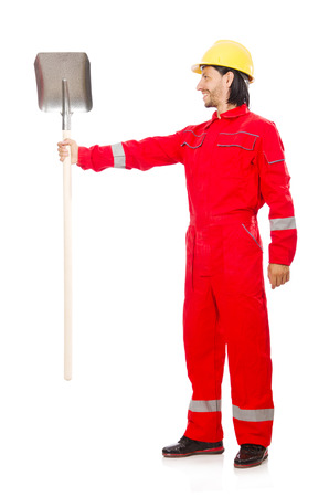 Man in red coveralls with spade Stock Photo