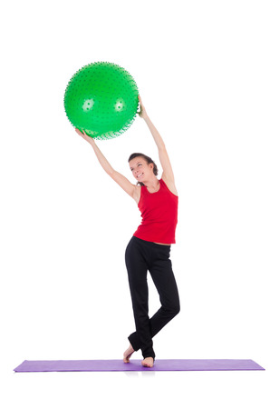 Young woman exercising with swiss ball Stock Photo