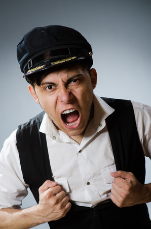 Funny taxi driver wearing peaked cap Stock Photo