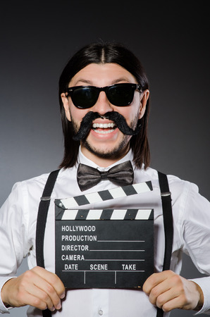 clapboard: Funny man with movie clapboard Stock Photo