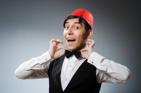 fez: Man wearing traditional turkish hat fez Stock Photo