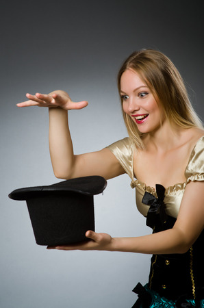 conjuror: Woman magician with magic wand and hat Stock Photo