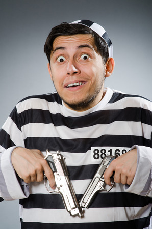 Funny prison inmate with gun photo