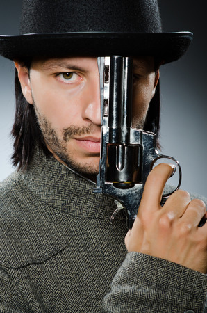 Man with gun and vintage hat Stock Photo