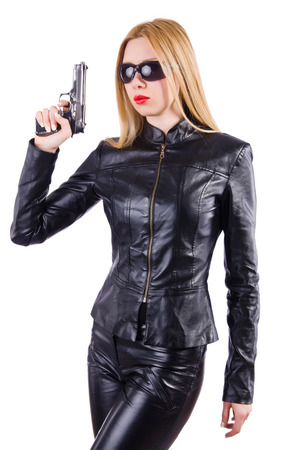 Woman with gun isolated on the white photo
