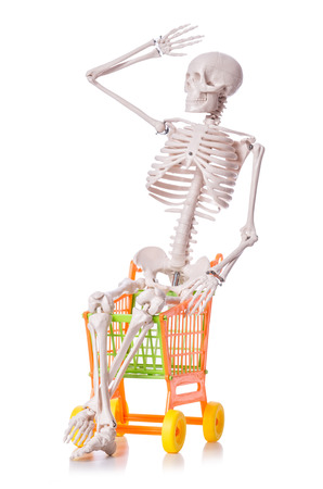 Skeleton with shopping cart trolley isolated on white