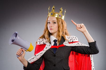 Queen businessman with loudspeaker in funny concept photo