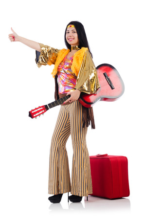 Travelling musician with suitcase and guitar photo