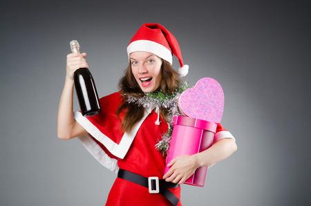 Snow santa girl in christmas concept photo