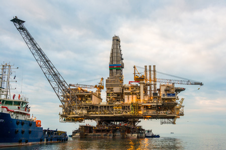 oil tool: Oil rig platform in the calm sea Stock Photo