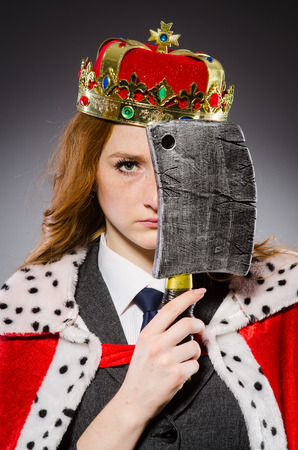 Woman queen businesswoman with axe photo
