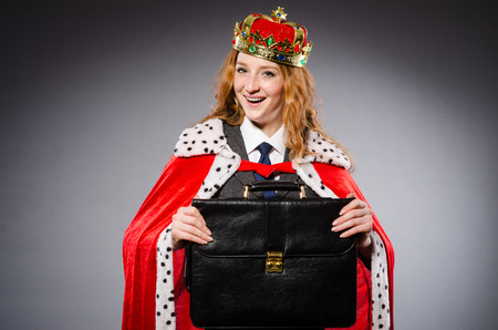 irate: Woman queen businesswoman in funny concept
