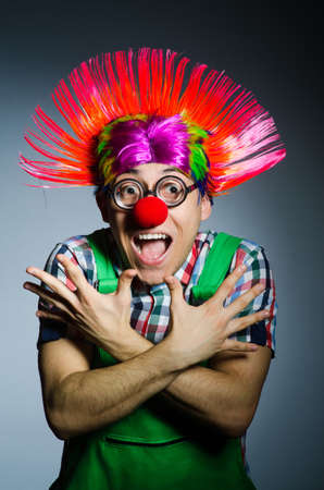 disillusioned: Funny clown against the grey background