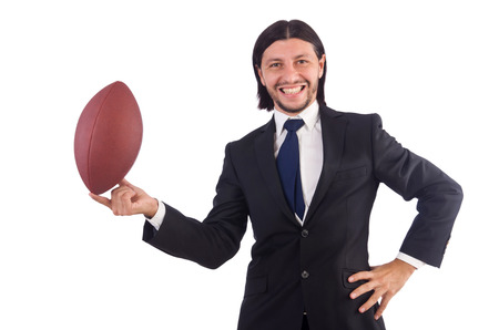 Businessman with football isolated on white photo