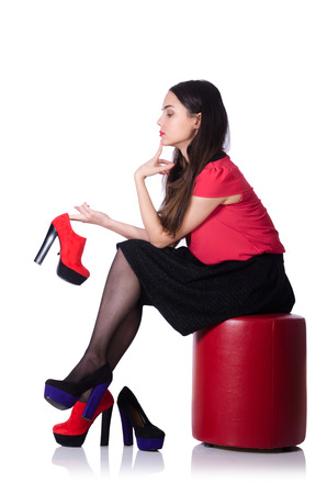 Woman trying new shoes isolated on the white photo
