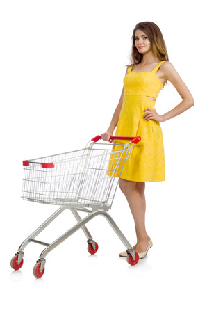 reach customers: Woman with shopping trolley isolated on white