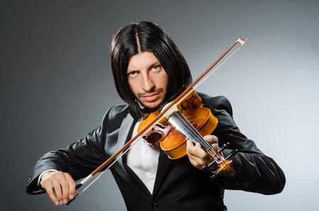 virtuoso: Man violin player in musican concept