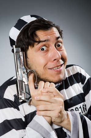 an inmate: Funny prison inmate with gun