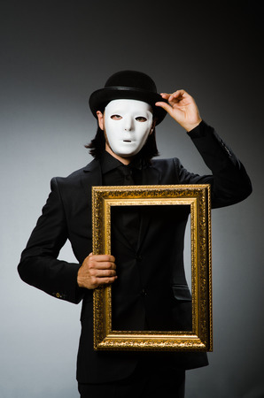 Funny concept with theatrical mask photo