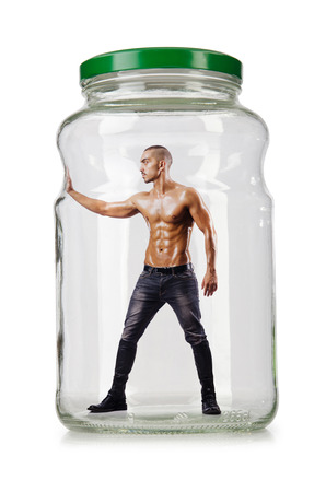 jailed: Muscular ripped man in glass jar