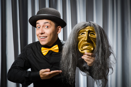 theatrical: Funny concept with theatrical mask Stock Photo