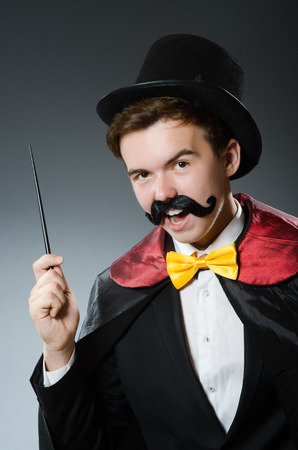 conjuror: Funny magician with wand and hat