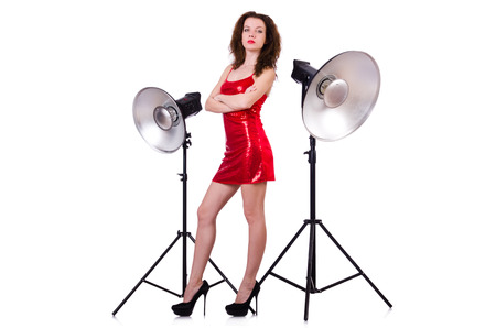 barndoors: Woman in red dress posing in the studio